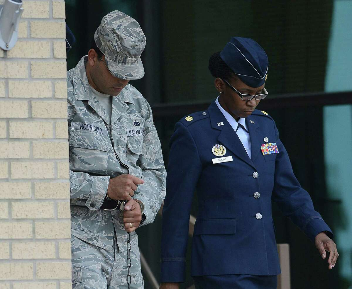 Air Force Tech Sergeant Jaime Rodriguez, left, exits the court at Lackland Air Force Base where he was sentenced for sex crimes on Friday, June 14, 2013.