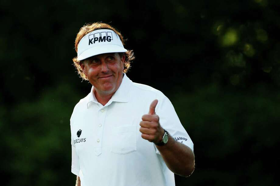 ARDMORE, PA - JUNE 14: Phil Mickelson of the United States smiles as he walks off the 11th tee during Round Two of the 113th U.S. Open at Merion Golf Club on June 14, 2013 in Ardmore, Pennsylvania. Photo: Rob Carr, Getty Images / 2013 Getty Images