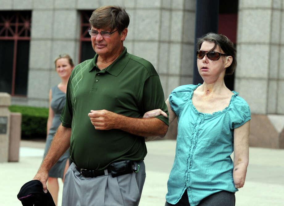 Charla Nash leaves the Legislative Office Building in Hartford, Conn., accompanied by her brother Steve Nash, following a hearing before the state Claims Commissioner Friday, August 10, 2012.  Nash is seeking permission from the commissioner to sue the state for $150 million in damages from a 2009 chimpanzee attack. Photo: Autumn Driscoll / Connecticut Post