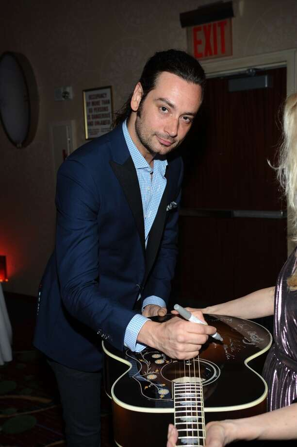 NEW YORK, NY - JUNE 13:  Constantine Maroulis signs guitar at the Songwriters Hall of Fame 44th Annual Induction and Awards Dinner at the New York Marriott Marquis on June 13, 2013 in New York City.  (Photo by Gary Gershoff/Getty Images for Songwriters Hall Of Fame)