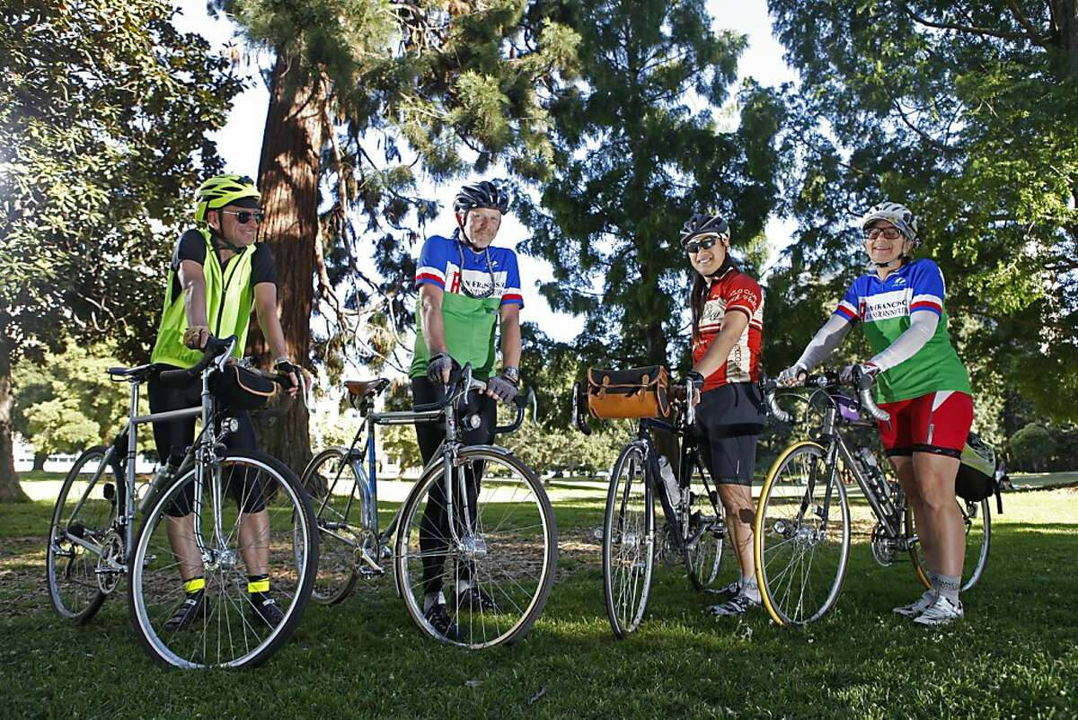 Martin Meyer, Rob Hawks, Jason Pierce and Kitty Goursolle gather in Mosswood Park for a group portrait in Oakland, CA on Thursday, June 13. The group participate in randonneuring, a form of long-distance bicycle touring.