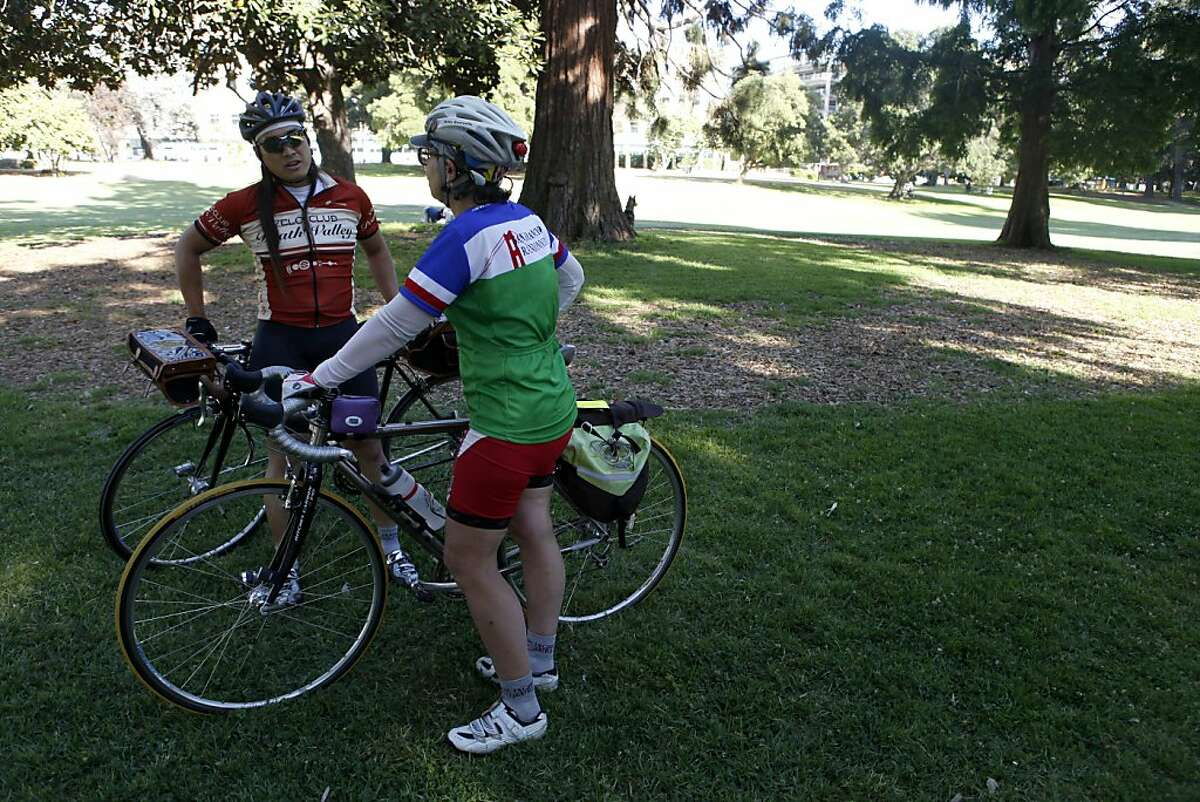 Jason Pierce and Kitty Goursolle chat in Mosswood Park, Oakland, CA on Thursday, June 13. The group participate in randonneuring, a form of long-distance bicycle touring.