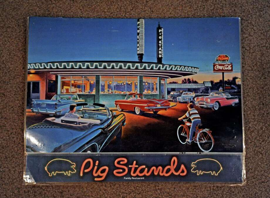 Beaumont artist Randy Welborn featured Pig Stand #41 on the front of their menu. Once a popular hangout for residents in the Golden Triangle. Photo taken: Randy Edwards/The Enterprise