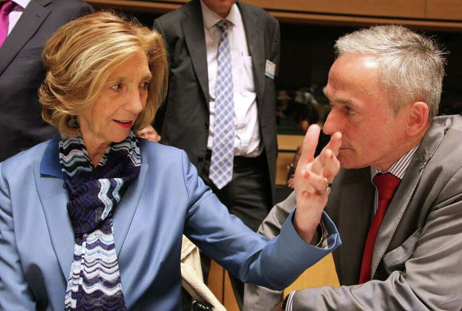 French minister for foreign trade Nicole Bricq talks with Irish enterprise minister Richard Bruton at the EU trade ministers' meeting in Luxembourg. Photo: Yves Logghe / Associated Press