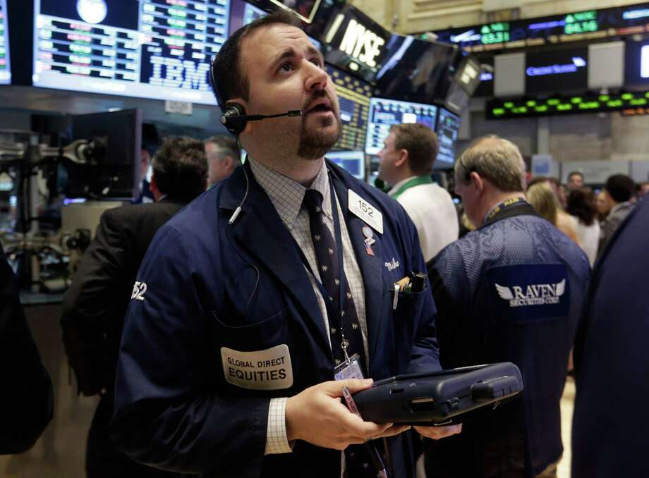 Trader Michael Mozian works on the floor of the New York Stock Exchange Monday, June 10, 2013. Asian stocks rebounded Friday June 14, 2013 from Tokyo's sharp decline after investors were encouraged by positive U.S. economic news. (AP Photo/Richard Drew) Photo: Richard Drew