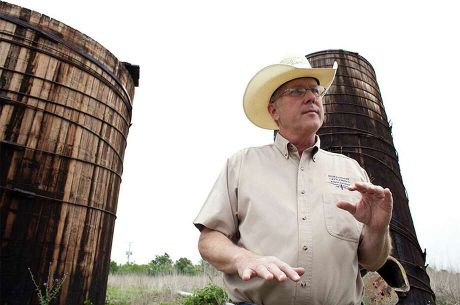 Stuart Carter, a landowner near Luling, has loads of abandoned oil equipment on his property. Photo: Callie Richmond / Texas Tribune