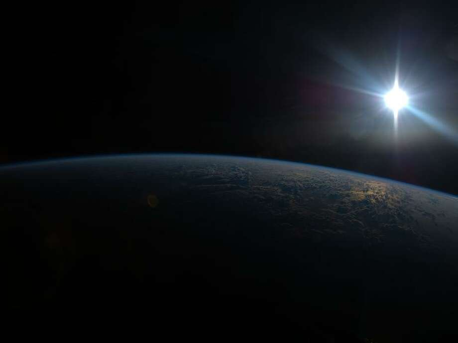 One of the Expedition 36 crew members aboard the International Space Station, flying at altitude of approximately 257 miles above the Indian Ocean, recorded this image of the sun about to go down on June 2, 2013. Photo: NASA