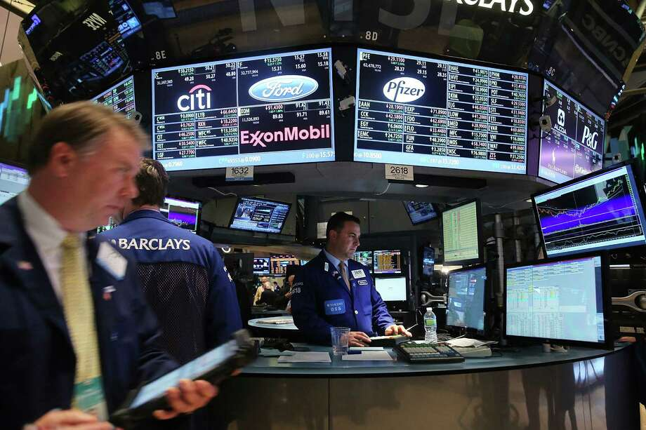 Several theories are going around Wall Street since Fed Chairman Ben Bernanke said the Federal Reserve might cut back its stimulus. Photo: Spencer Platt / Getty Images