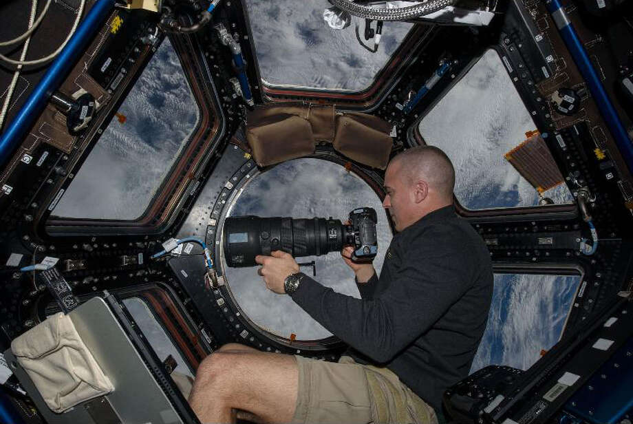 Inside the Cupola, NASA astronaut Chris Cassidy, an Expedition 36 flight engineer, eyeballs a point on Earth some 250 miles below him and the International Space Station. Cassidy has been aboard the orbital outpost since March and will continue his stay into September. Photo: NASA