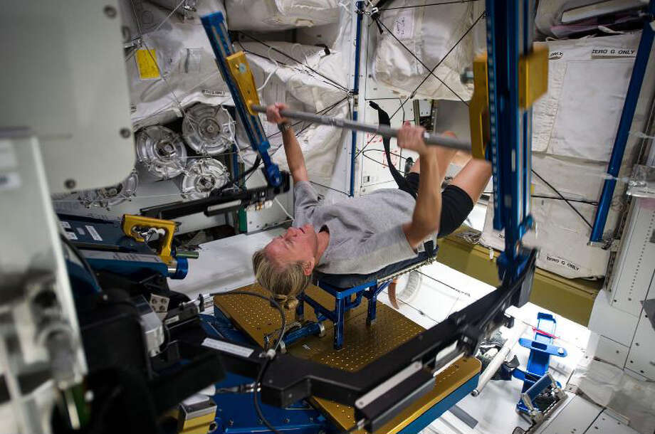 NASA astronaut Karen Nyberg, Expedition 36 flight engineer, gets a workout on the Advanced Resistive Exercise Device (ARED) in the Tranquility node.