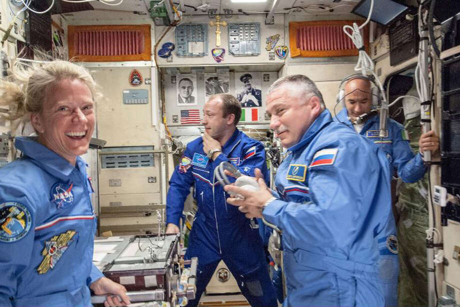 This image, photographed inside the Zvezda service module, is one of the first scenes showing interaction among the Expedition 36 crew members already onboard the International Space Station and the three freshly arrived crew members on May 29, 2013. Having made the trip from Baikonur, Kazakhstan aboard the Soyuz TMA-09M and greeted here by cosmonaut Alexander Misurkin (frame center) of Russia's Federal Space Agency (Roscosmos), are, from the left, Flight Engineers Karen Nyberg of NASA, Fyodor Yurchikhin of Roscosmos and Luca Parmitano of the European Space Agency.