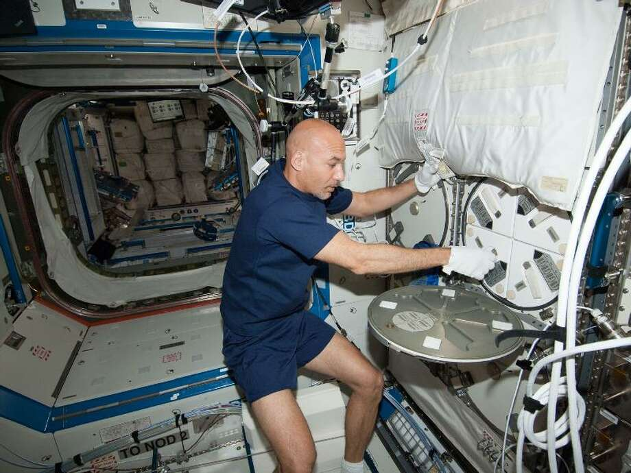 European Space Agency astronaut Luca Parmitano, Expedition 36 flight engineer, works with samples in Minus Eighty-Degree Laboratory Freezer for ISS (MELFI-3) in the Destiny laboratory of the Earth-orbiting International Space Station.