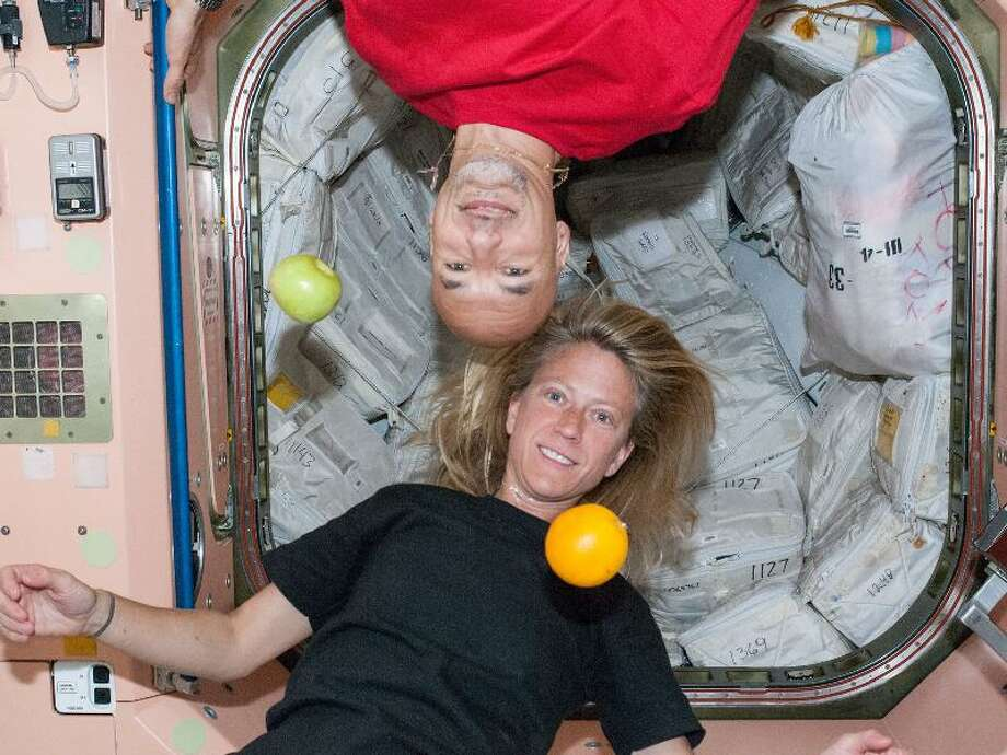 When off-duty time comes for crew members aboard the Earth-orbiting International Space Station, astronauts often like to take advantage of the micro-gravity to do things that they can't do on Earth, such as hang upside down or suspend fruit in air. Here, Flight Engineers Karen Nyberg of NASA and Luca Parmitano of the European Space Agency find a spot in the Unity node to their liking for a brief recess.