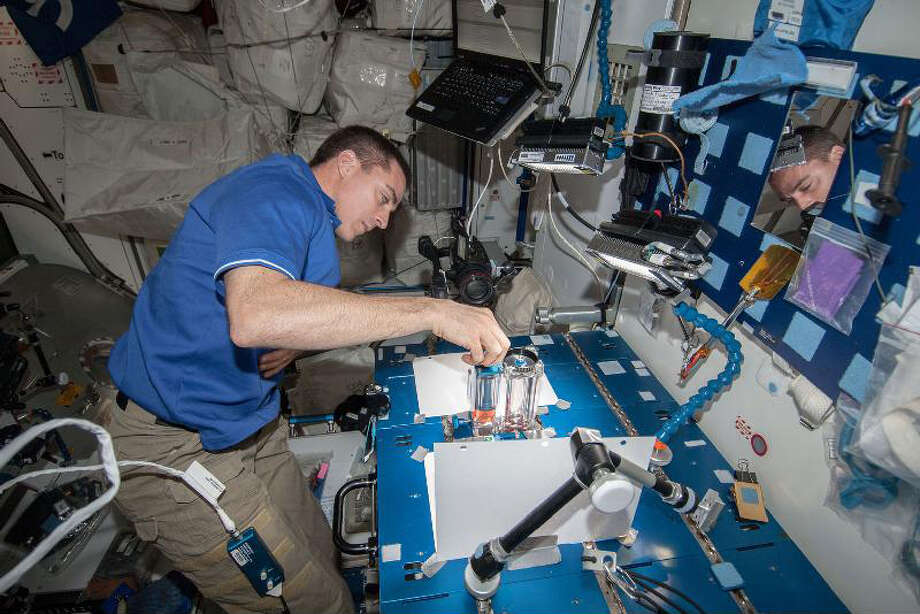 NASA astronaut Chris Cassidy, Expedition 36 flight engineer, works on the Capillary Flow Experiment aboard the International Space Station on May 22, 2013.