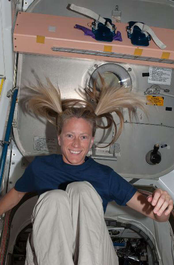 It's recess time for a floating astronaut Karen Nyberg, Expedition 36 flight engineer, in the Unity node aboard the International Space Station.