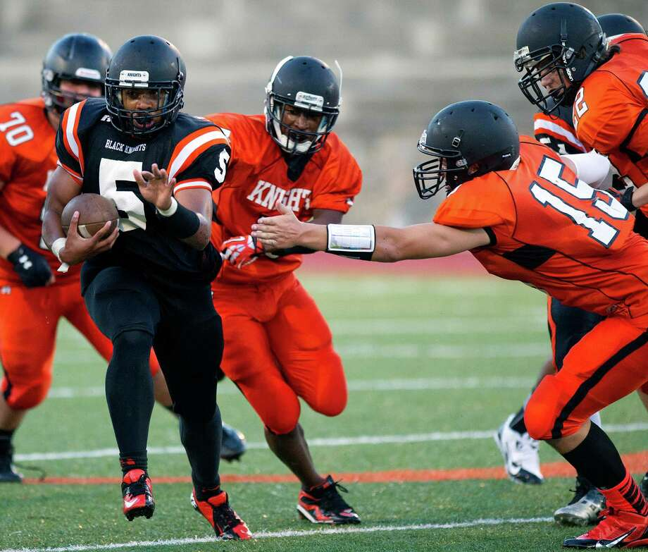 Cameron Webb carries the ball during Friday's spring football game at Stamford High School on June 14, 2013. Photo: Lindsay Perry / Stamford Advocate