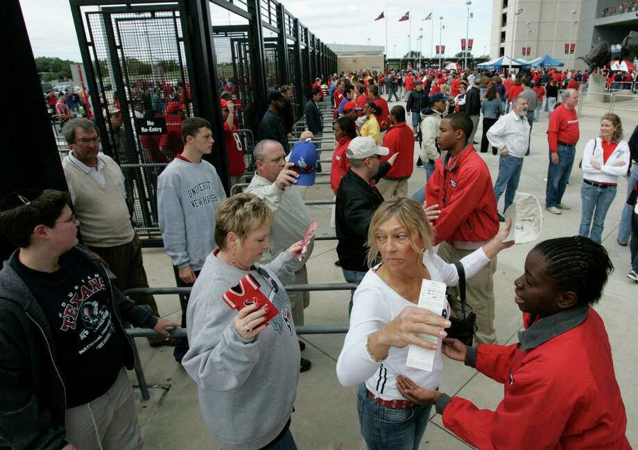 Texans fans are searched as they enter Reliant Stadium before a 2006 game against the Jacksonville Jaguars. Starting next season, the NFL will not allow bags larger than 12 inches by 6 inches by 12 inches into stadiums on game days. Photo: BRETT COOMER, STAFF / Houston Chronicle