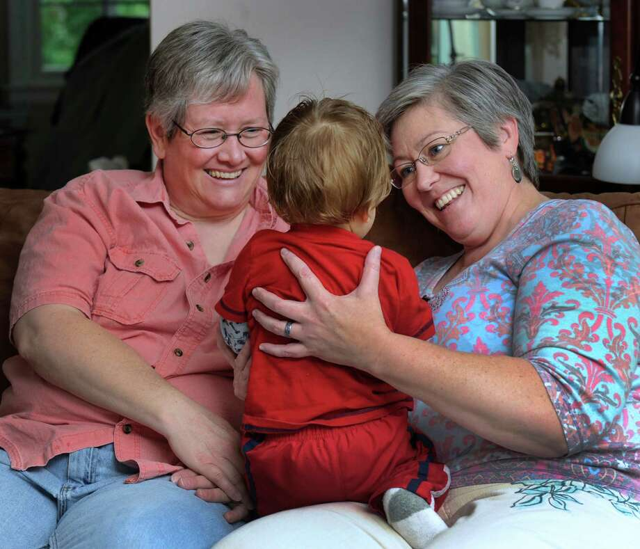 Jackie McNeil, 47, left, and Cindy Maddox, 49, foster parents to a 1-year-old boy, are photographed at their home in Danbury, Conn, Friday, June 14, 2013. Photo: Carol Kaliff / The News-Times