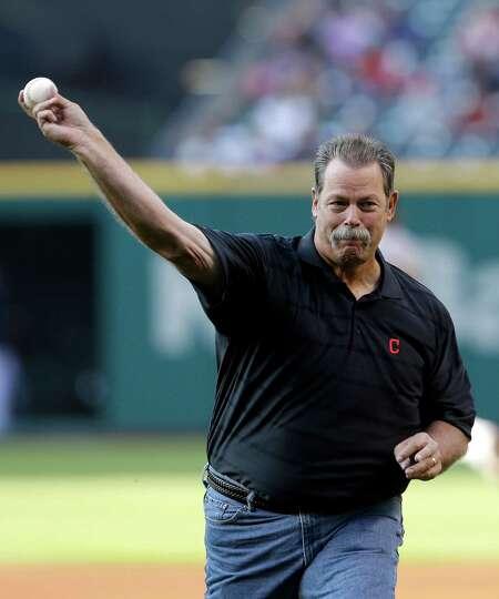 Former Cleveland Indians relief pitcher Doug Jones throws out the ceremonial first pitch before Clev