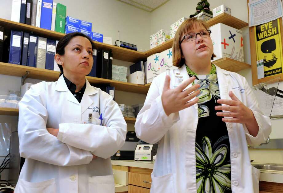 Rina Siddiqui, left, a molecular genetic pathologist, and Shannon Morrill-Cornelius, a genetic counselor, discuss a recent Supreme Court decision, at Danbury Hospital in Danbury, Conn., Friday, June 13, 2013. Photo: Carol Kaliff / The News-Times