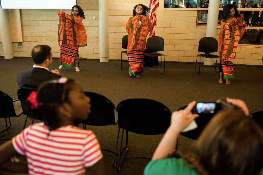 Dancers perform following a naturalization ceremony put on by the Citizenship and Immigration Services, Seattle District 20, OneAmerica and the Seattle Office of Immigrant and Refugee Affairs on Friday, June 14, 2013, at Seattle City Hall in Seattle. The ceremony was part of a larger event celebrating Flag Day, which included local artists, face painting, crafts for kids and resources for new citizens. Photo: JORDAN STEAD, SEATTLEPI.COM / SEATTLEPI.COM