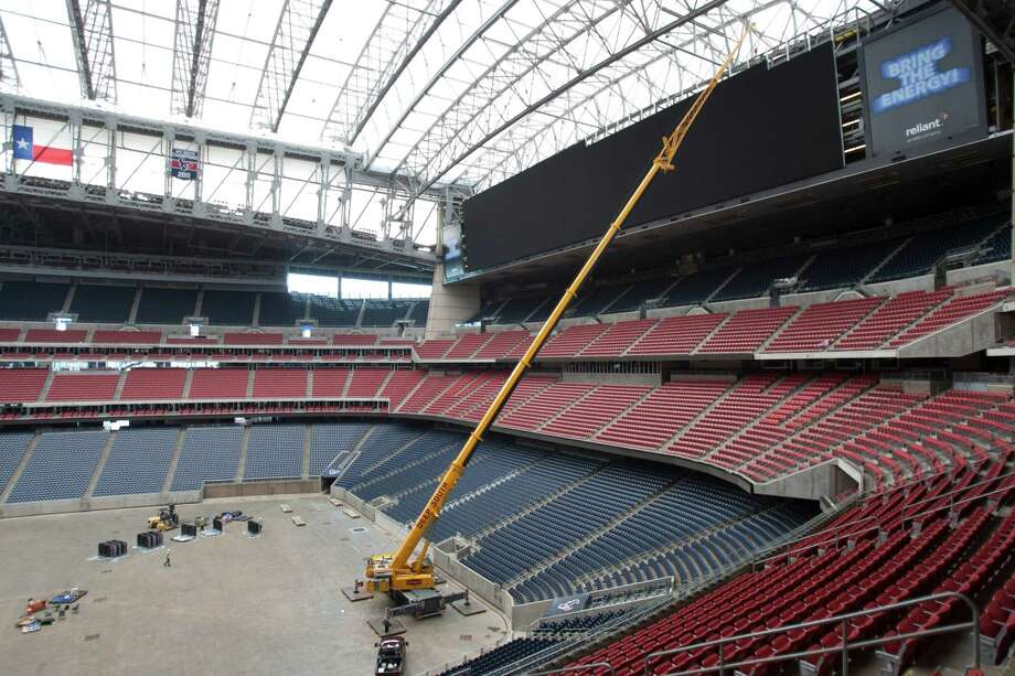 Installation of the Diamond Vision video boards — the largest in-stadium, high-definition displays in the world — continued at Reliant Stadium on Friday. Each end-zone video board consists of 297 pieces weighing 500 pounds each. The 14,549-square-foot display boards are scheduled to be ready for the Texans' preseason opener against Miami on Aug. 17. Photo: Brett Coomer, Houston Chronicle / © 2013 Houston Chronicle