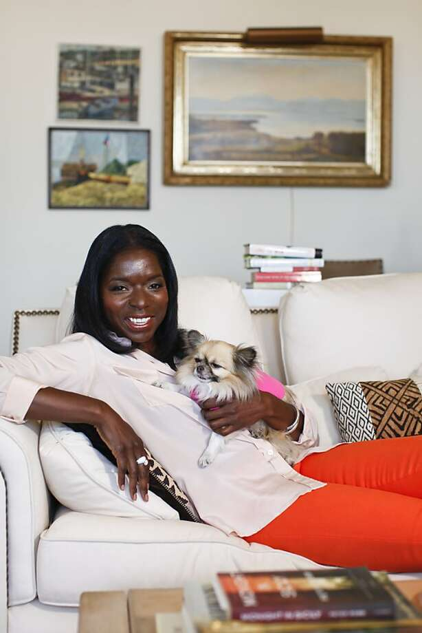 Kelly E. Carter, with her dog Lucy, made the most of her travel experience, love of animals and writing skills to start TheJetSetPets.com, which tracks luxury accommodations for travelers' furry companions. Photo: Russell Yip, The Chronicle