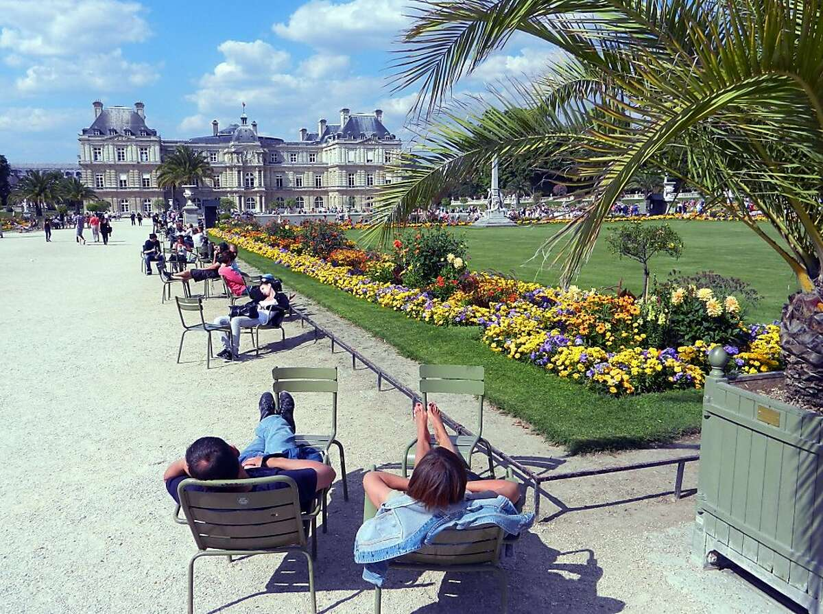 Parisians practice artful relaxation in the oasis of Luxembourg Garden.