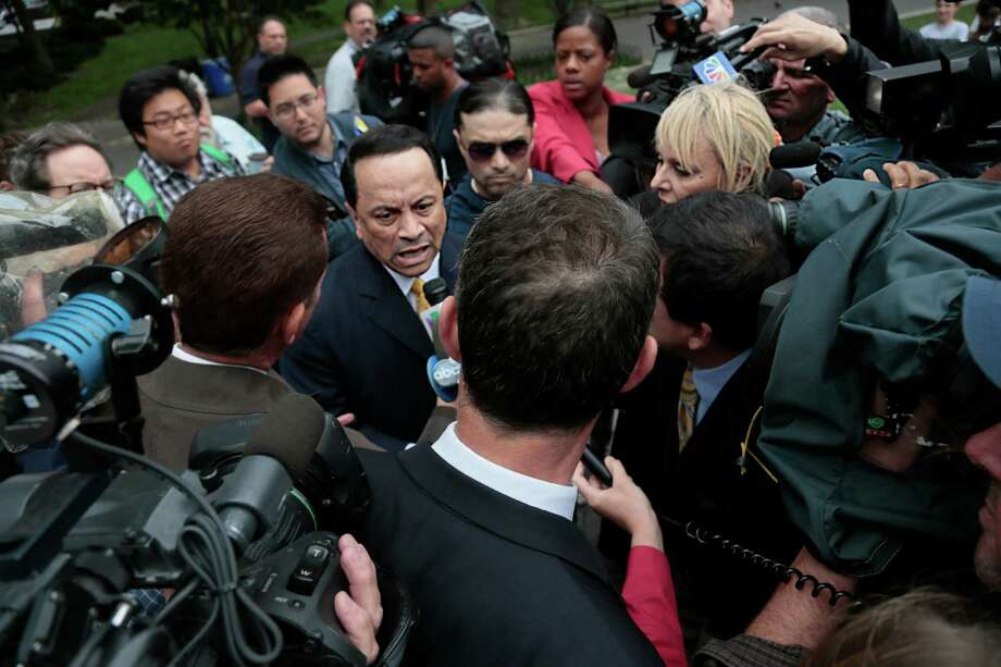 Former state Sen. Pedro Espada Jr., center, speaks as he arrives at Brooklyn federal court on Friday, June 14, 2013 in New York. Espada could face seven years in prison at sentencing after pleading guilty to tax fraud charges. (AP Photo/Bebeto Matthews) Photo: Bebeto Matthews
