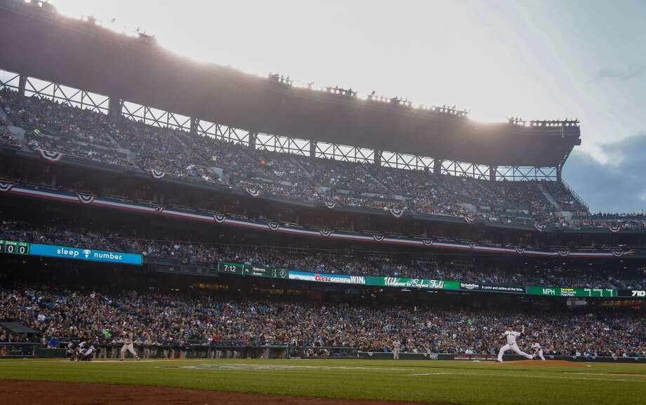 The Mariners won their home opener against the Houston Astros, riding pitcher Joe Saunders to a 3-0 win before more than 42,000 fans.