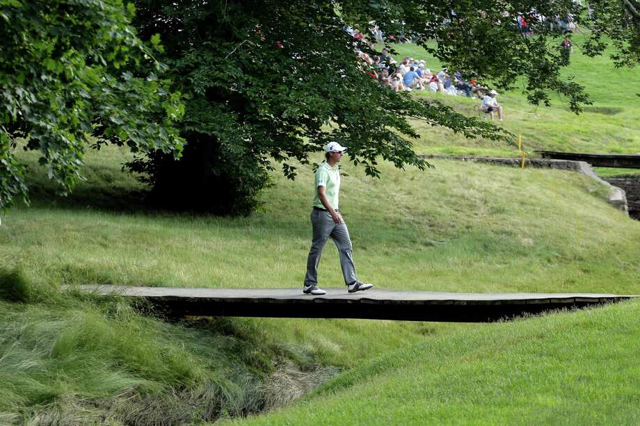 Nicolas Colsaerts, of Belgium, walks across a bridge on the 10th hole during the second round of the U.S. Open golf tournament at Merion Golf Club, Friday, June 14, 2013, in Ardmore, Pa. (AP Photo/Charlie Riedel) Photo: Charlie Riedel, Associated Press / AP