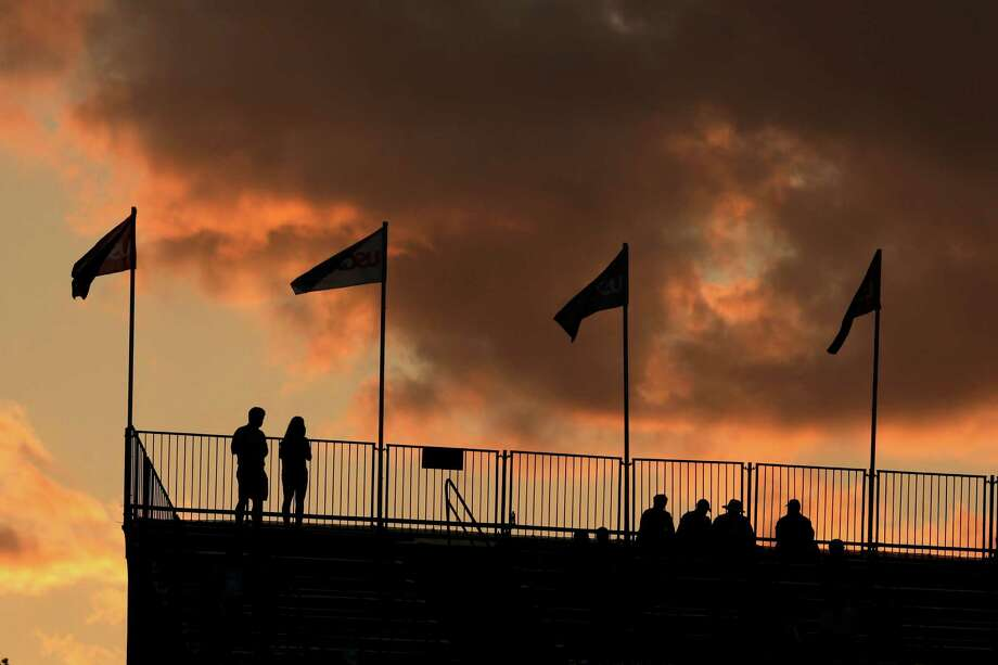 Spectators watch play from the grandstands on the 17th hole during the second round of the U.S. Open golf tournament at Merion Golf Club, Friday, June 14, 2013, in Ardmore, Pa. (AP Photo/Charlie Riedel) Photo: Charlie Riedel, Associated Press / AP