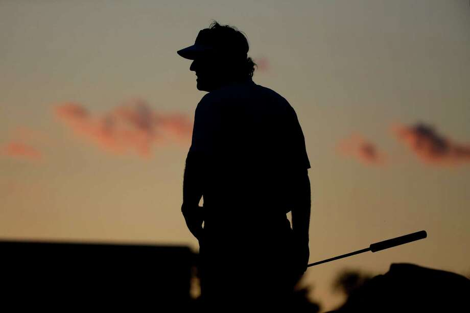 Phil Mickelson waits to putt on the 18th green during the second round of the U.S. Open golf tournament at Merion Golf Club, Friday, June 14, 2013, in Ardmore, Pa. (AP Photo/Morry Gash) Photo: Morry Gash, Associated Press / AP