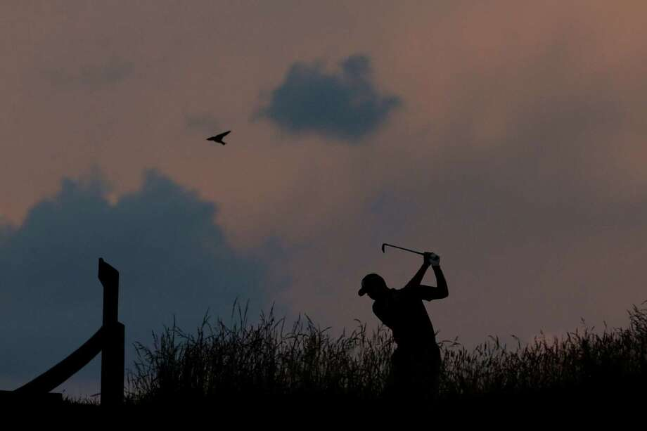 Matt Kuchar tees off on the 17th hole during the second round of the U.S. Open golf tournament at Merion Golf Club, Friday, June 14, 2013, in Ardmore, Pa. (AP Photo/Charlie Riedel) Photo: Charlie Riedel, Associated Press / AP