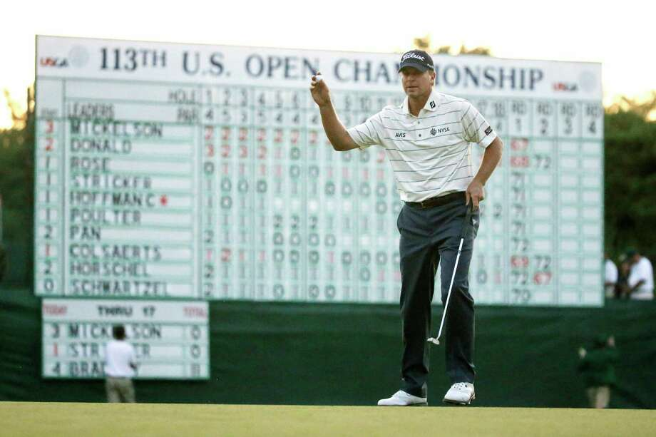 Steve Stricker reacts after putting on the 18th green during the second round of the U.S. Open golf tournament at Merion Golf Club, Friday, June 14, 2013, in Ardmore, Pa. (AP Photo/Morry Gash) Photo: Morry Gash, Associated Press / AP