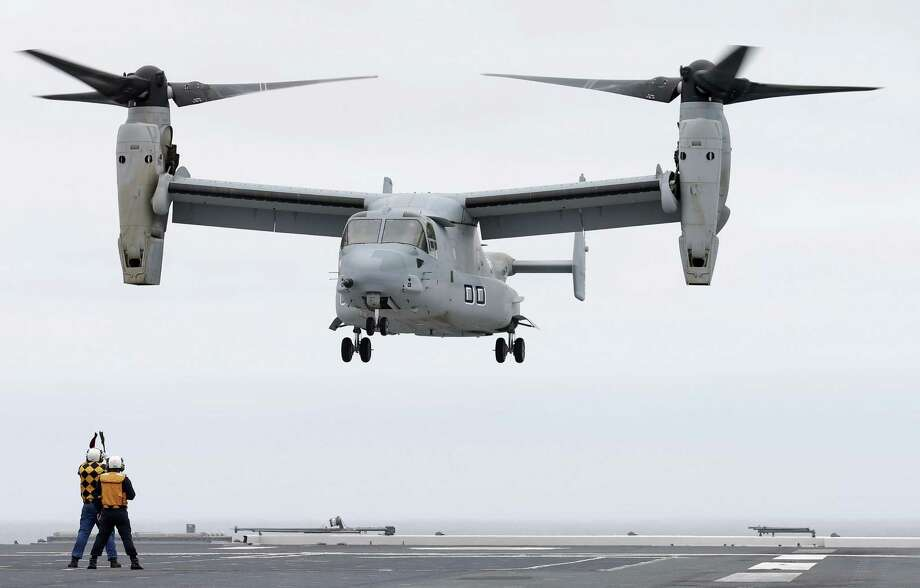 A U.S. Marine MV-22 Osprey aircraft lands on the Japanese destroyer JS Hyuga in coastal waters off San Diego, Calif. The Osprey has sparked protests in Japan over safety concerns. Photo: Photos By Gregory Bull / Associated Press
