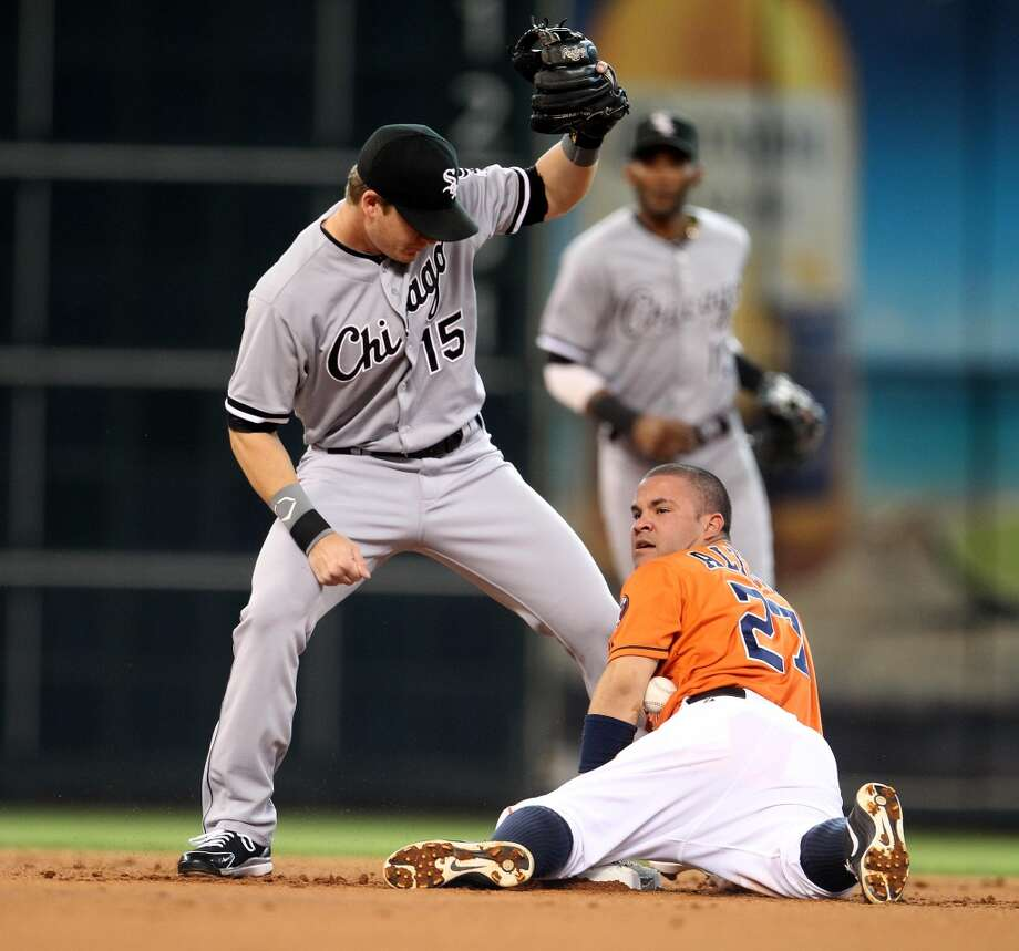 Astros second baseman Jose Altuve (27) steals second base.