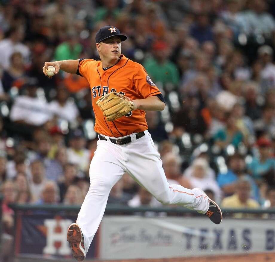Astros third baseman Matt Dominguez (30) tries to make the throw to first on a single by White Sox left fielder Casper Wells.