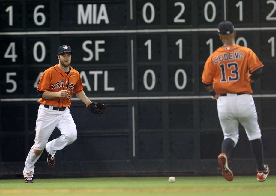 Astros left fielder Trevor Crowe (8) and shortstop Ronny Cedeno (13) chase a double hit by White Sox first baseman Paul Konerko.