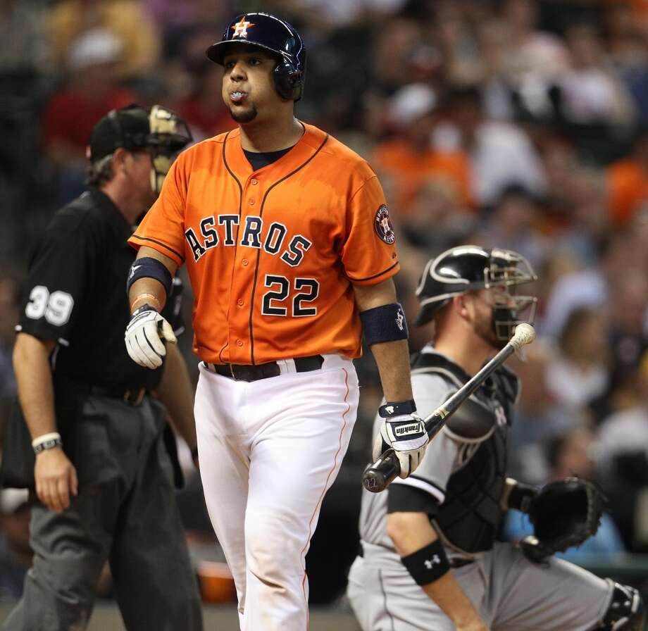 Astros catcher Carlos Corporan (22) strikes out.