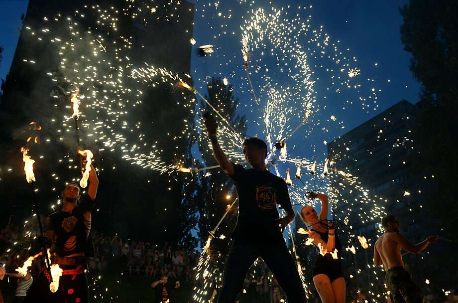 Artists perform during the opening of the International Kiev Fire Fest 2013 on June 14, 2013, in Kiev. About 500 artists from all over the world are taking part in the Fest.  AFP PHOTO / SERGEI SUPINSKYSERGEI SUPINSKY/AFP/Getty Images Photo: Sergei Supinsky, AFP/Getty Images