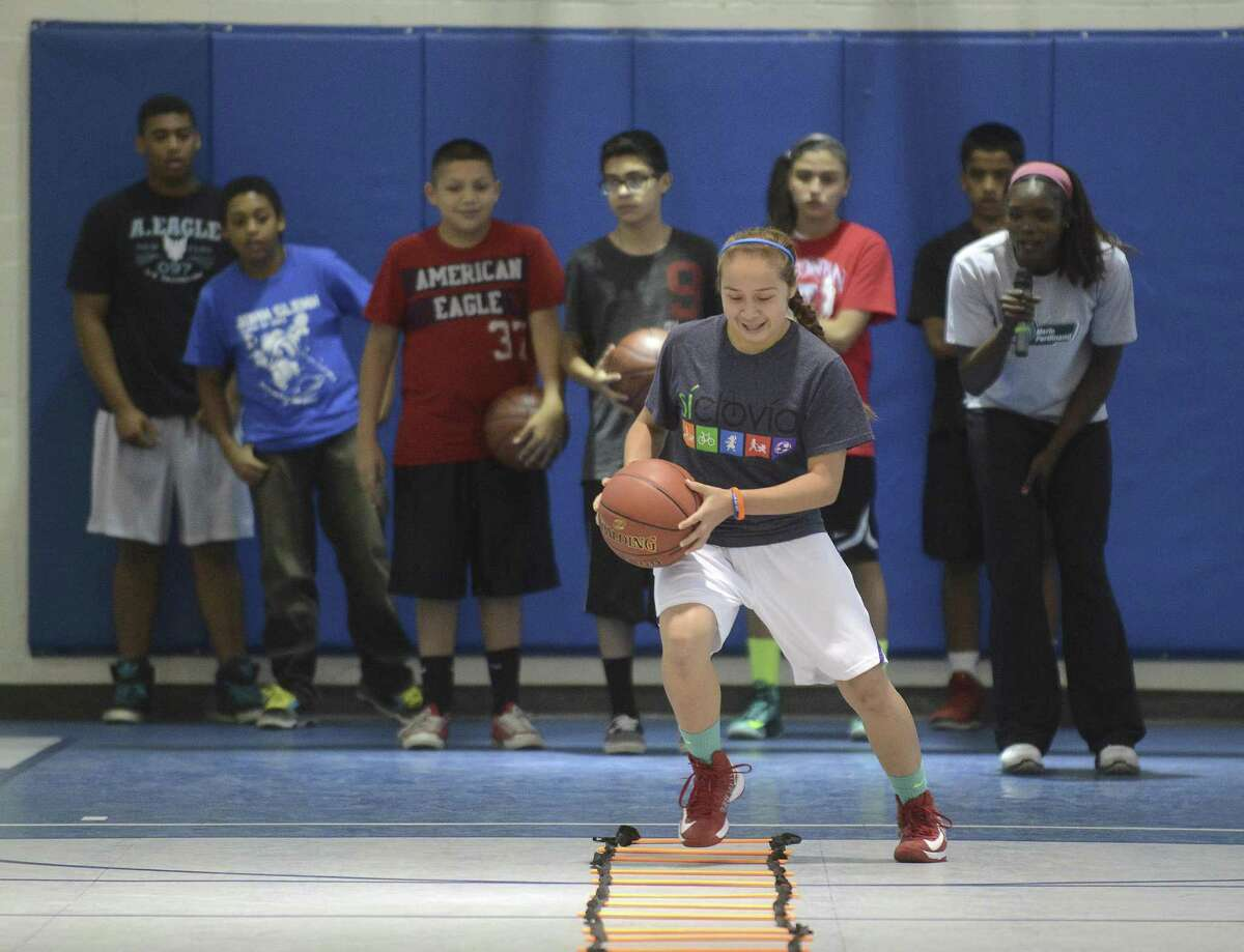 Avery Alva participates in a basketball drill during an