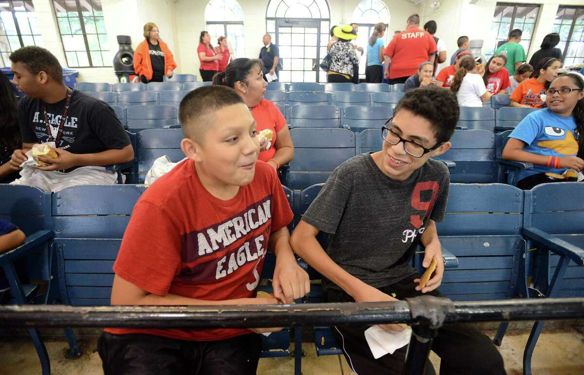 Alvaro Perez, left, and Arnold Avila share a laugh during an