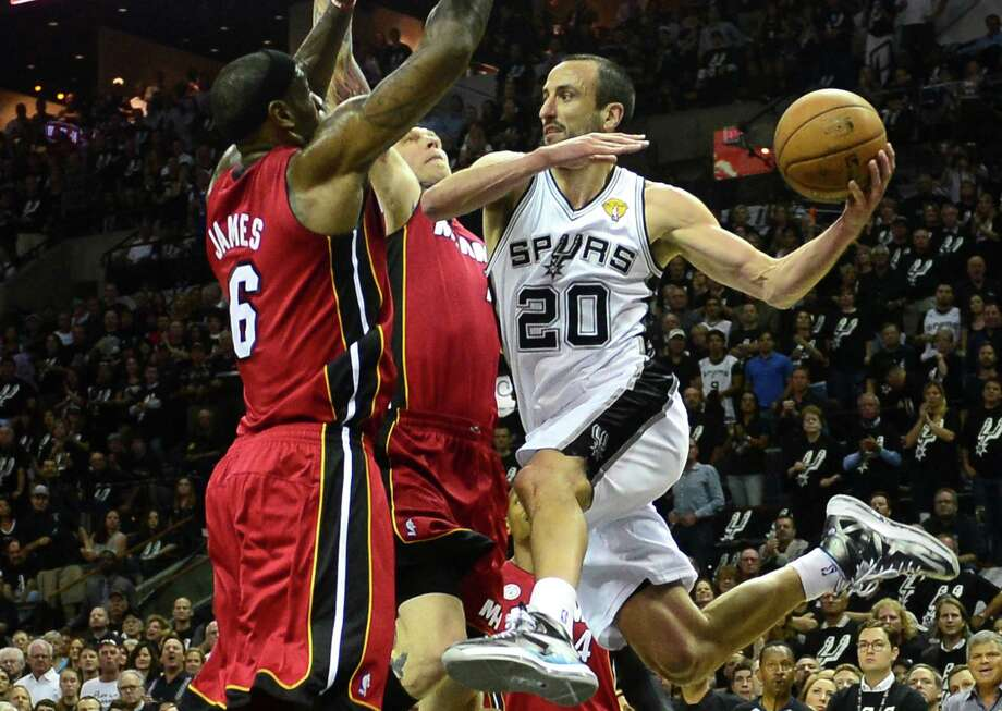 Manu Ginobili (R) of the San Antonio Spurs looks to pass under pressure from LeBron James (L) and Chris Andersen of the Miami Heat during game three of the NBA Finals on June 11, 2013 in San Antonio, Texas. AFP PHOTO/Frederic J. BROWNFREDERIC J. BROWN/AFP/Getty Images Photo: FREDERIC J. BROWN, Staff / AFP