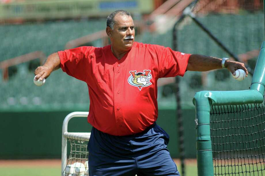 ValleyCats manager Ed Romero pitches the ball for batting practice on Friday, June 14, 2013, at Joseph L. Bruno Stadium in Troy, N.Y. (Cindy Schultz / Times Union) Photo: Cindy Schultz / 00022789A
