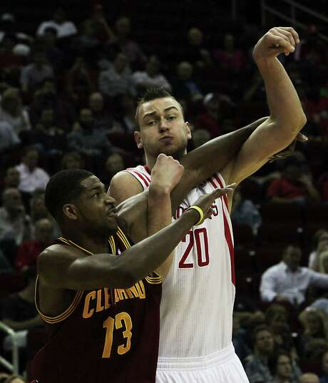 Donatas Motiejunas, right, is bulking up to hold his own in the paint against interior players like Tristan Thompson. Photo: James Nielsen, Staff / © 2013 Houston Chronicle