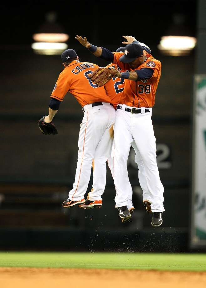 June 14: Astros 2, White Sox 1Astros left fielder Trevor Crowe (8), right fielder Jimmy Paredes (38) and center fielder Brandon Barnes (2) celebrate their win over the White Sox.