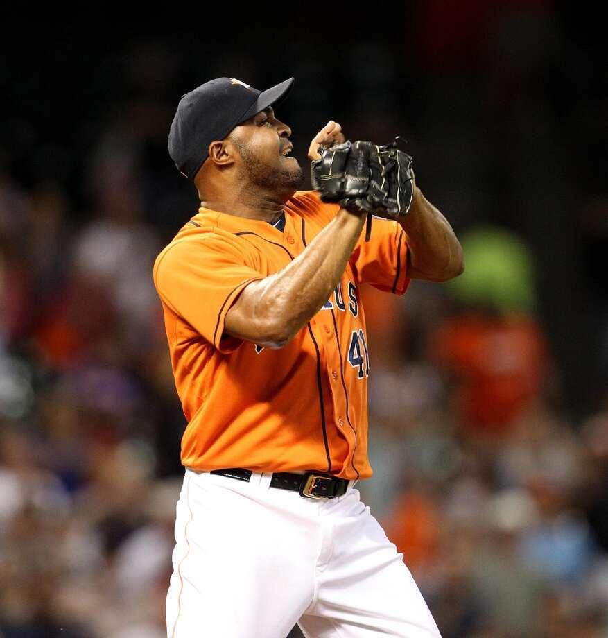 Astros relief pitcher Jose Veras celebrates the win.