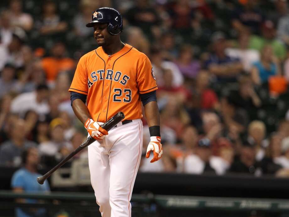 Astros left fielder Chris Carter strikes out.