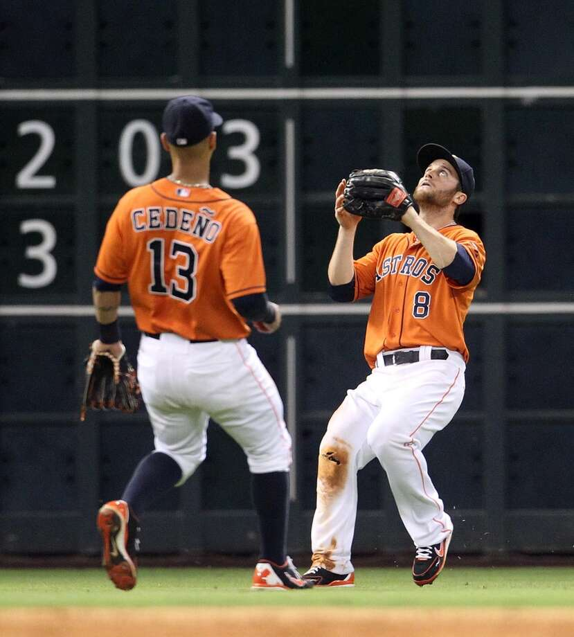 Astros left fielder Trevor Crowe prepares to make a catch on a pop out by White Sox left fielder Dayan Viciedo.